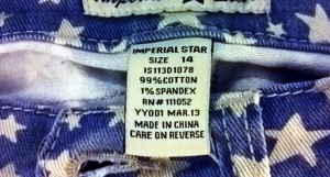 "photo of denim cutoffs with a USA flag pattern and a ""Made in China"" label"
