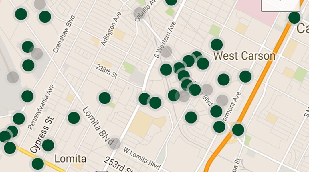 screencap from the Geocaching mobile app showing caches near the user
