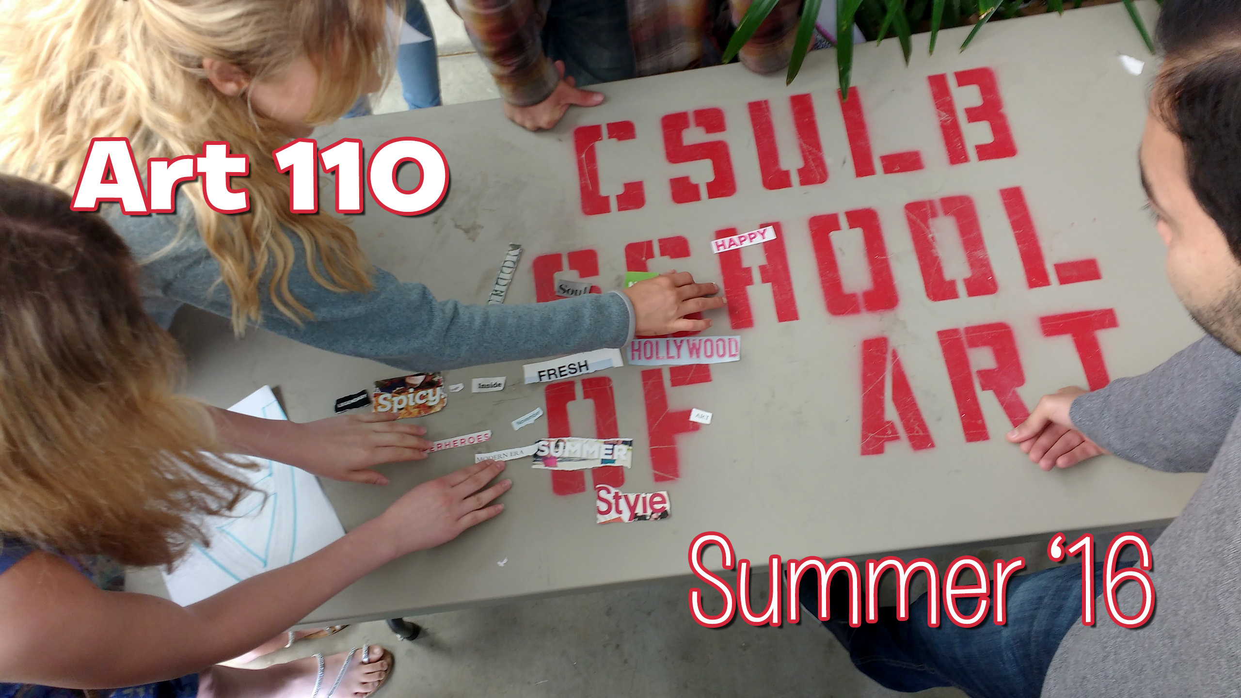 "Students arranging ""words"" torn from magazines on a large table that has the stenciled words ""CSULB SCHOOL OF ART"" on it's surface. CSULB School of Art, Dutzi Gallery, May 2016."